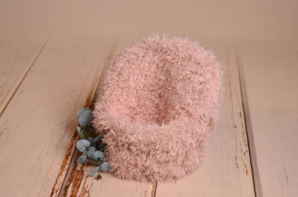 Pink armchair cover with feathers