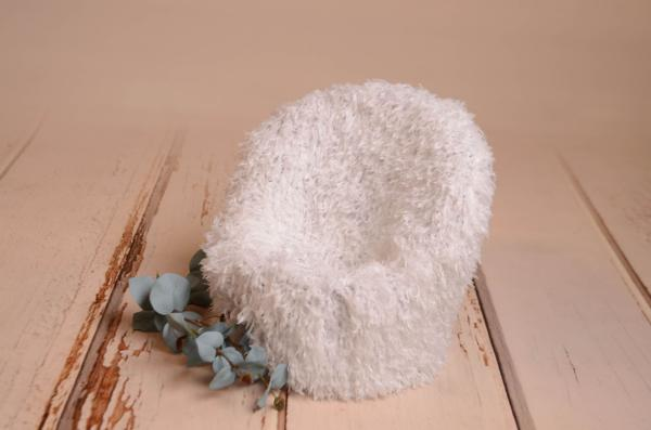 White armchair cover with feathers