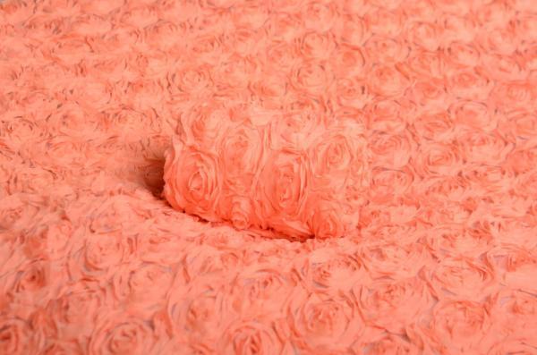 Tissu fleurs saumon avec tares