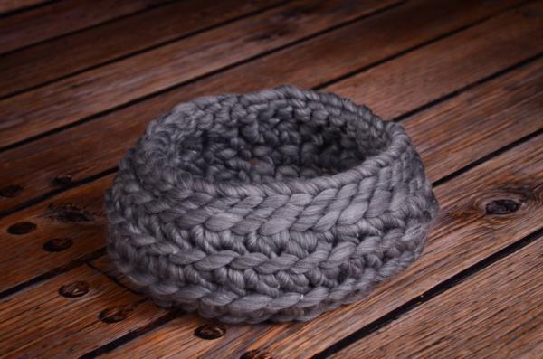 Dark grey plaited wool basket