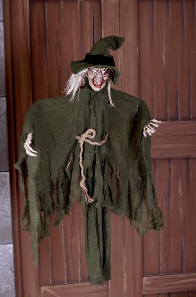 Green hanging witch