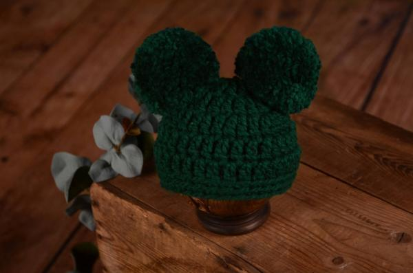 Dark green hat with pompoms