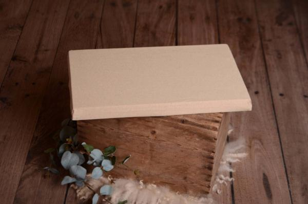 Mattress with speckled beige cover