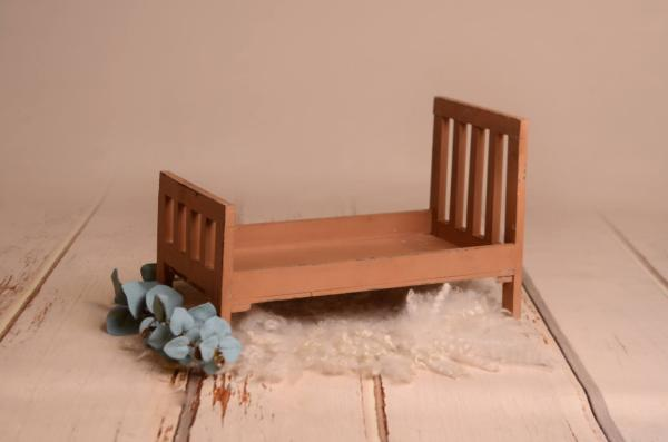 Brown rustic bed with straight headboard